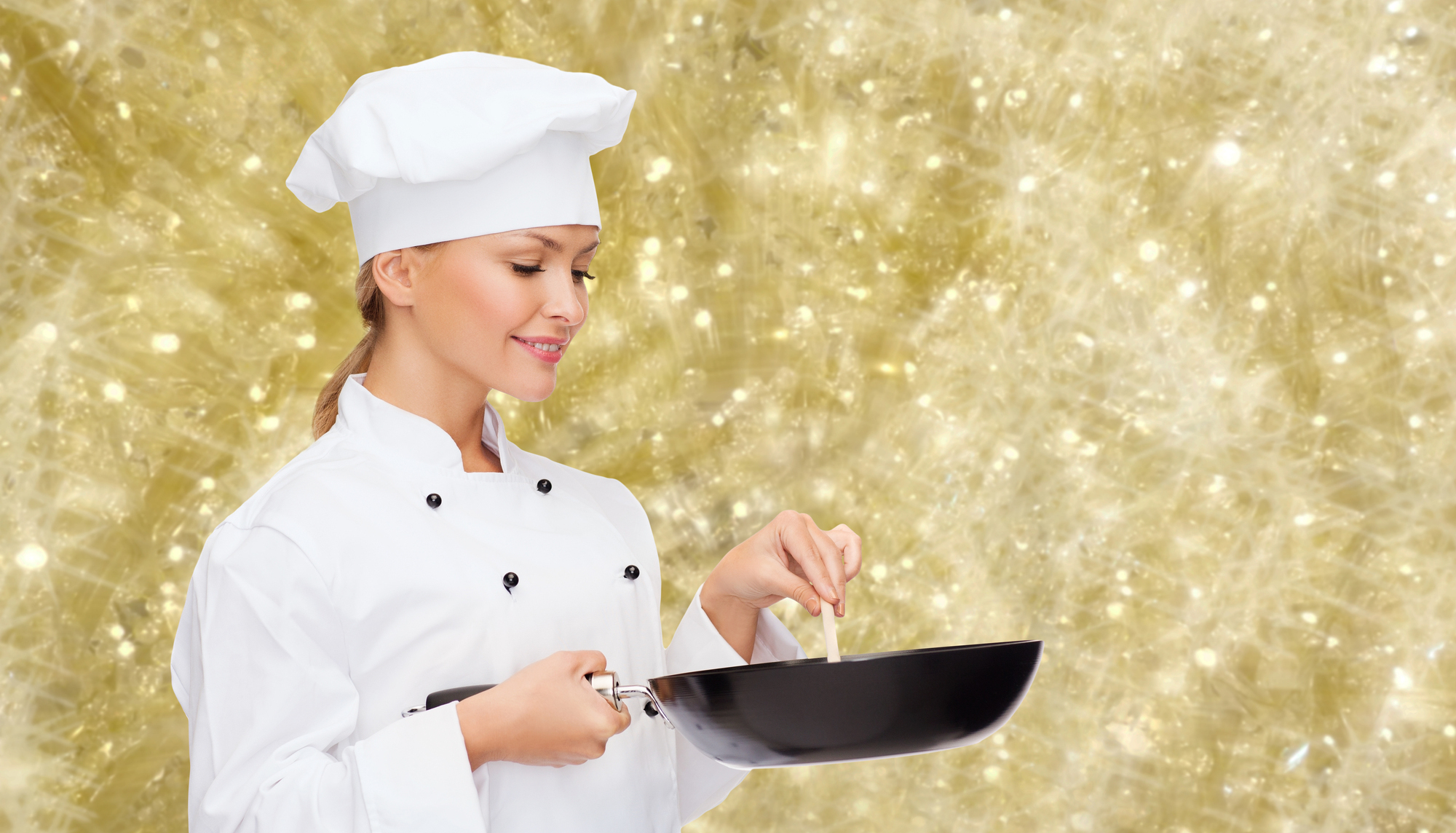 smiling female chef with pan and spoon