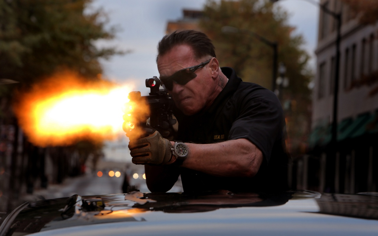 TEN RZ PRINTS Arnold fires from atop truck Nov 19 2012 xl CH__0519.tif