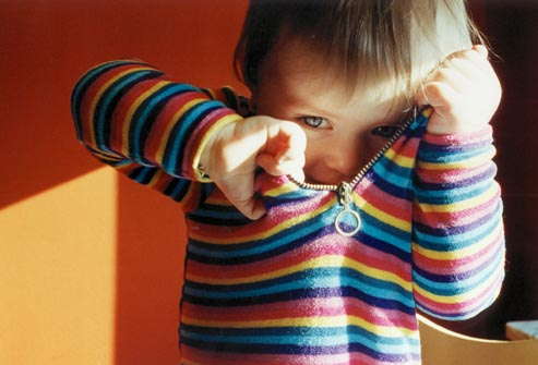 getty_rm_photo_of_child_putting_on_shirt