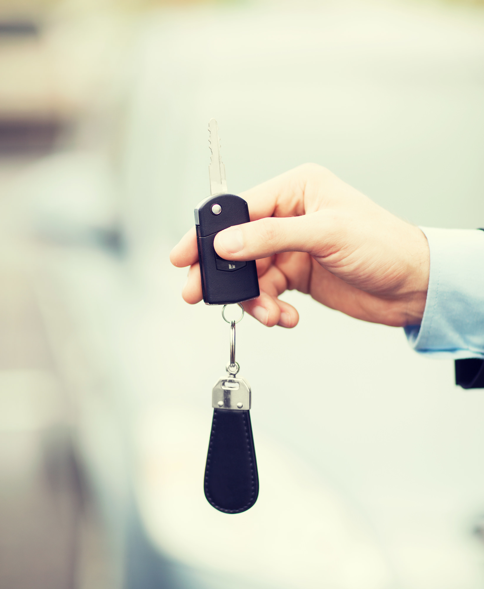 man with car key outside