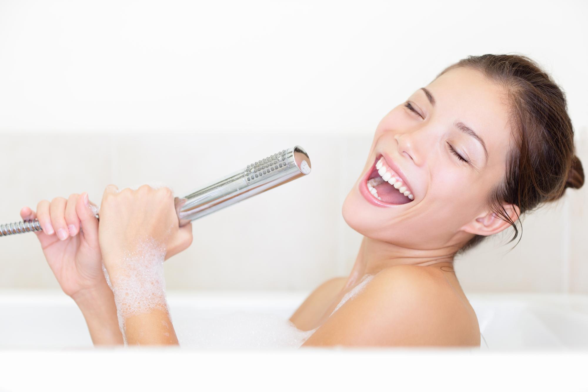 Bath woman singing in bathtub