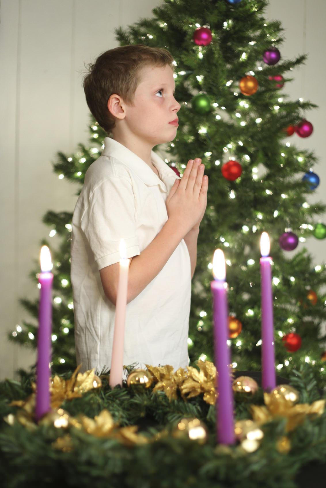 christmas boy praying