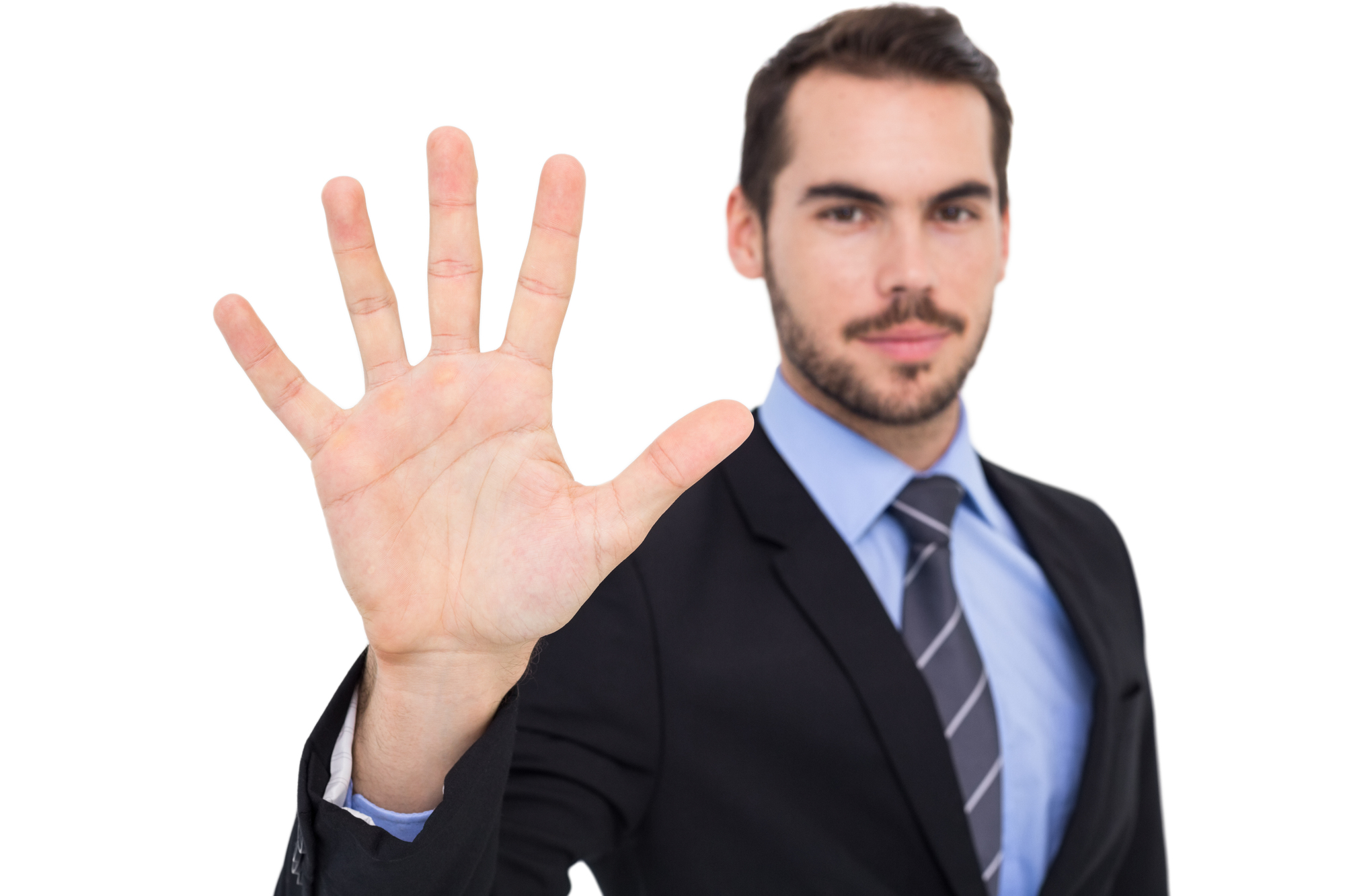 Smiling businessman with fingers spread out on white background