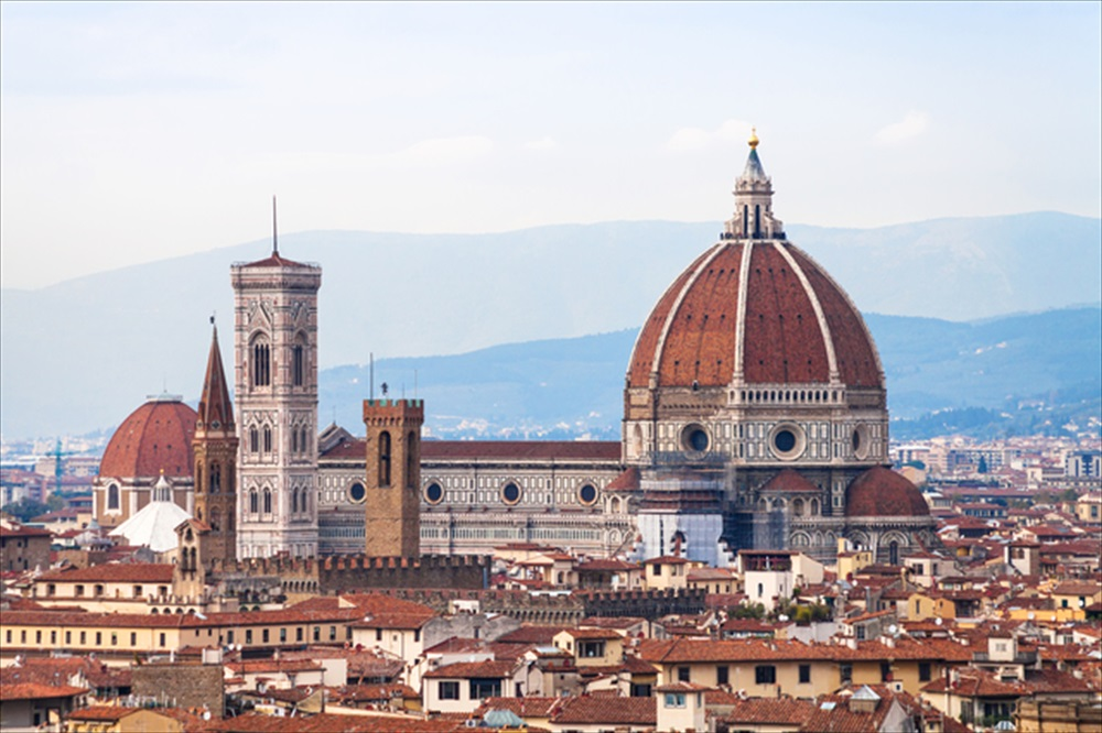 travel to Italy - above view of Duomo Cathedral in Florence city from Piazzale Michelangelo in autumn evening