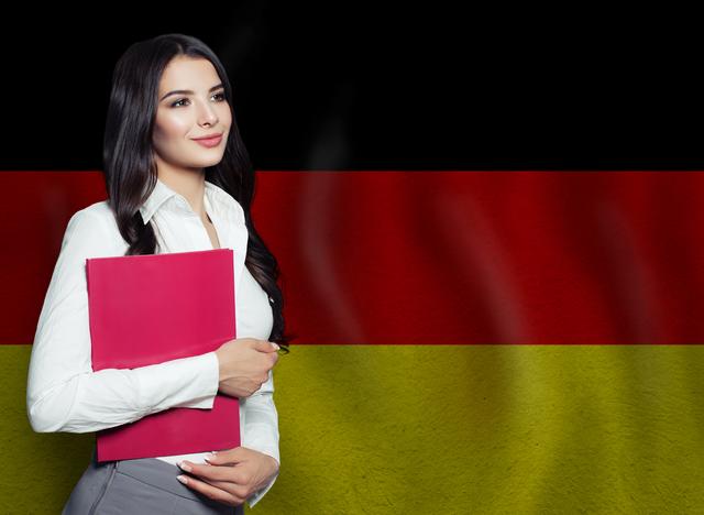 ドイツの国旗と学者風の女性