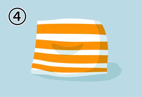 白地に太いオレンジボーダーのクッション