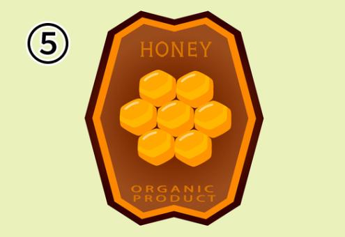 蜂の巣イメージの六角形がデザインされたはちみつラベル