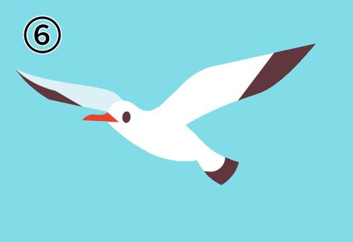 羽を広げて左向きに飛ぶカモメ
