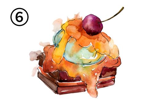 チョコレートケーキに、オレンジのソース、緑のアイス、さくらんぼが乗ったケーキ