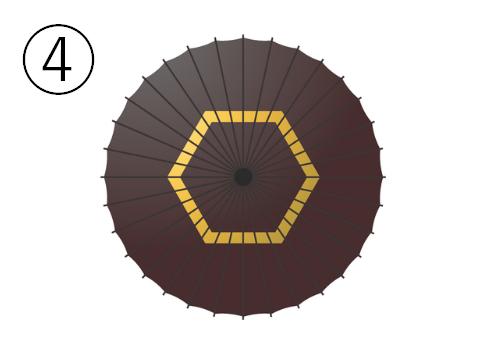 黄色い六角形の輪のある、濃い茶色の和傘