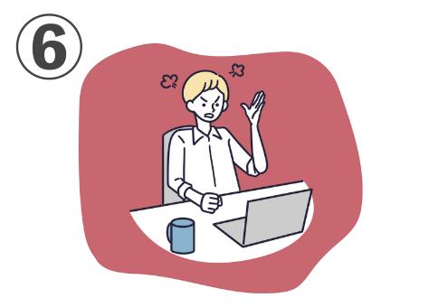 赤背景に、パソコンに向かって怒る人