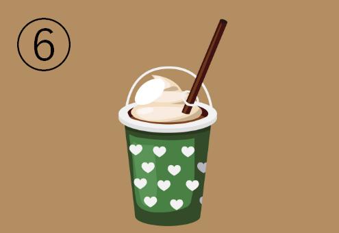 緑地に白いハート柄のカフェドリンクカップ