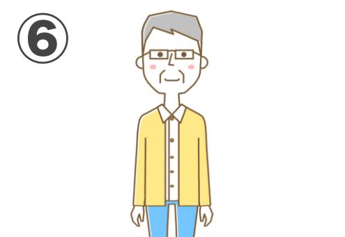 メガネ、グレーの短髪、シャツに黄色カーディガン、ジーンズのおじ様