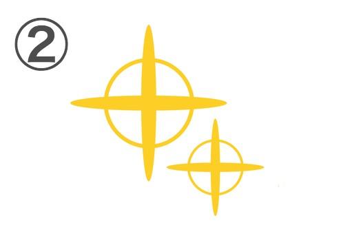十字に細い輪っかのついた、2つのキラキラ