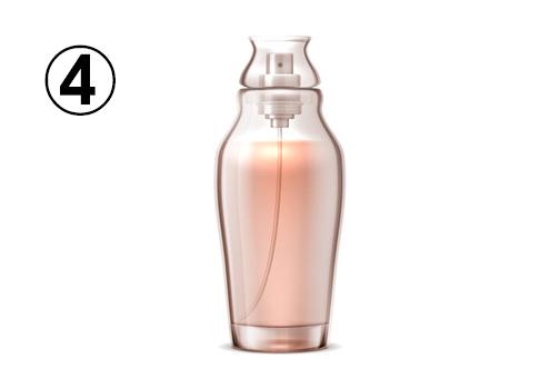 花瓶のような形のオレンジの香水瓶