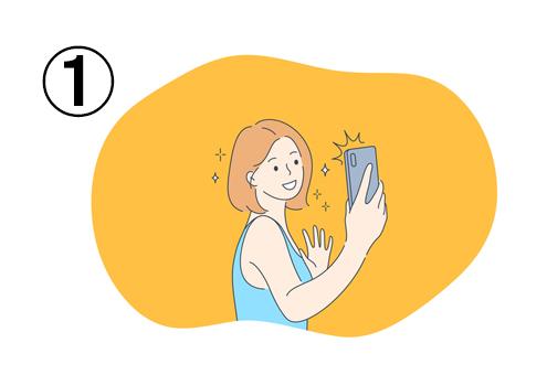 女性が手を振りながら、キラキラしたフィルターを付けて自撮り
