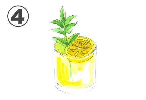ミント、レモンが浮かんだ黄色いカクテル