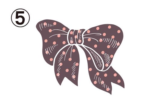 ピンクのドット柄の茶色いリボン