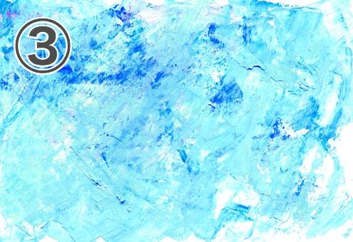 白地に水色と青の絵の具が散りばめられた絵