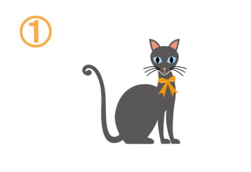 オレンジのリボンをしたグレー猫