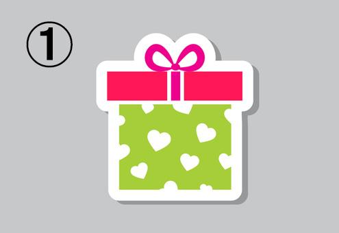 黄緑地に白いハート柄の箱、赤い蓋、ピンクのリボンのプレゼント