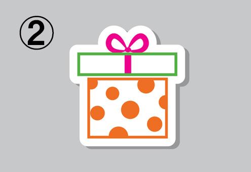 白地にオレンジのドットの箱、黄緑線の白蓋、ピンクリボンのプレゼント