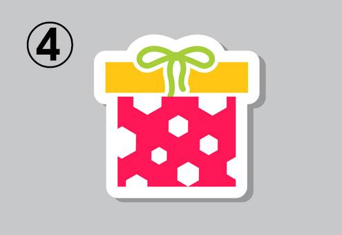 赤地に白い六角形柄、黄色い蓋、黄緑のリボンのプレゼント