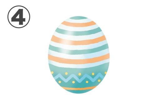白とオレンジのボーダー線、水色のギザギザ線のある、緑の卵