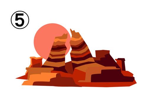 地層が目立つ赤系の山