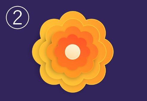 中心がオレンジの、雲のような黄色いペーパーフラワー