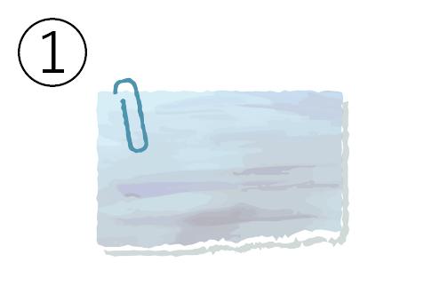 ネイビークリップの付いた水色のメモ帳