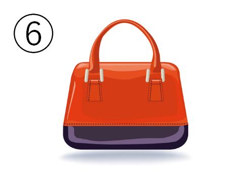 赤と黒のエナメルのバッグ