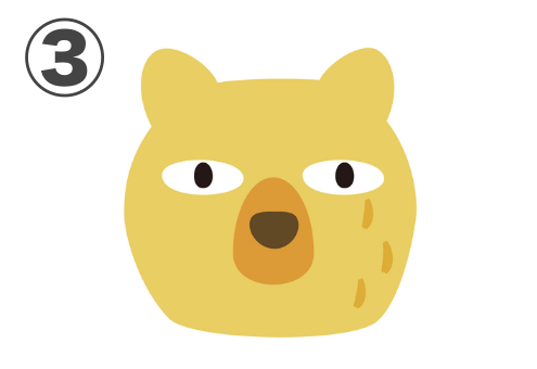 真顔で見つめる黄色いクマ