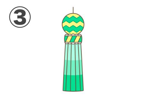黄色、緑メインの、ギザギザ線のある七夕飾り