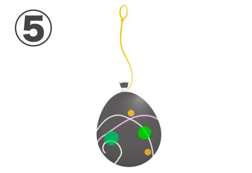 緑、黄色のドットと、白、薄ピンクのラインが入った黒のヨーヨー